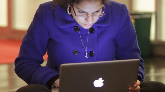 Photo of student on her Macaulay laptop