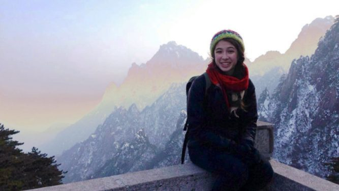 Macaulay student on mountaintop during study abroad trip