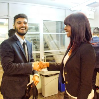 Student meeting an employer at the Macaulay career fair.
